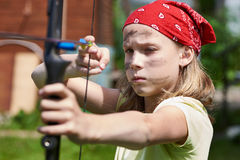 Girl archer with bow shooting Royalty Free Stock Images