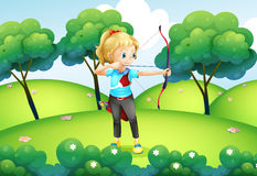 A girl with an archer at the hilltop Royalty Free Stock Photo