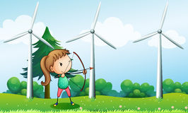 A girl with an archer near the windmills Stock Images