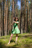 Girl archery in a summer forest Royalty Free Stock Photography