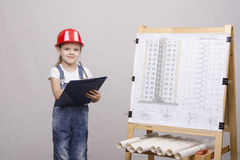 Girl architect is drawing near Royalty Free Stock Photography