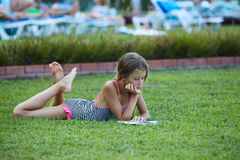 Free Girl Are Reading Book At Meadow Stock Images - 75725114