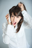 Girl arguing on the phone stock photography
