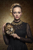 Girl with aristocratic lady mask. Carnival portrait of blonde woman with aristocratic antique lady mask, elegant lace dress and baroque jewellery. Venetian mask Stock Photography