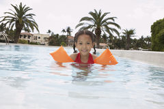 Girl With Armbands In Swimming Pool Royalty Free Stock Photos