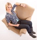 Girl on an armchair Royalty Free Stock Photo
