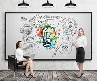 Girl in armchair and blond girl near colorful light bulb sketch Stock Photos
