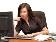 Girl in an armchair at the computer Stock Photo