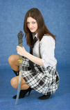 Girl armed with the japanese sword. On blue background Stock Photos