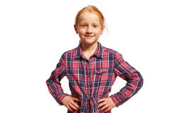 Girl with arms in the hips. Young girl with arms in the hips royalty free stock photo