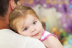 The girl in the arms of his father. Stock Image