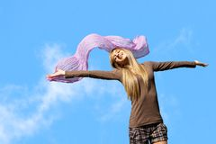 Girl with arms open outdoors. Happy young girl feeling free with arms open outdoors Stock Photos