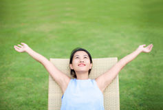 Girl arms open relaxing Stock Photo