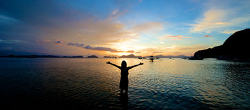 Girl arms open wide in El Nido. Girl with arms wide open in El Nido in the Philippines stock images