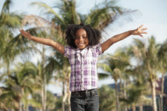 Girl with arms outstretched Stock Photos