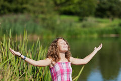 Girl With Arms Outstretched At Park Royalty Free Stock Images