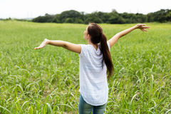 Girl with arms outstretched Stock Photography