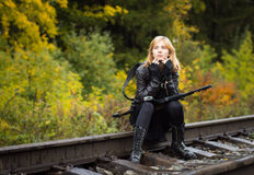 Girl with arms on the rails in autumn Stock Photography
