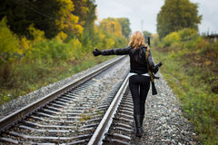 Girl with arms on the rails in autumn Royalty Free Stock Photography