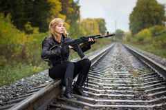 Girl with arms on the rails in autumn stock photos
