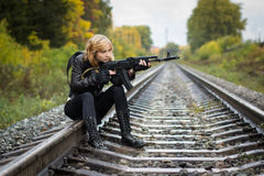 Girl with arms on the rails in autumn Stock Image