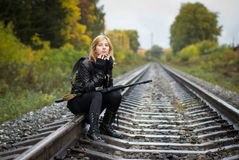 Girl with arms on the rails in autumn. Day Royalty Free Stock Photos