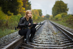 Girl with arms on the rails in autumn. Day Stock Image