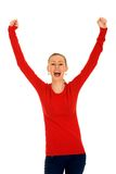 Girl with arms raised Stock Image