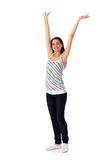 Girl with arms raised Stock Photo