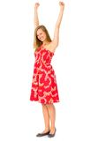 Girl with arms raised. Portrait of an attractive woman standing Stock Image