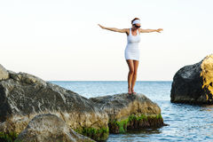 Girl with arms raised towards the sky Stock Photography