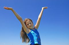 Girl with arms standing on Meadow Royalty Free Stock Photo