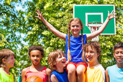 Girl with arms up on friends shoulders after game Stock Images
