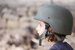 Girl in an army hat Stock Photography
