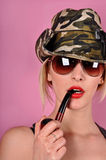 Girl with army hat and pipe Royalty Free Stock Photos