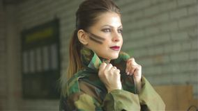 Girl in army uniform stock footage