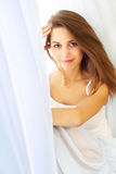 Girl around the curtain Royalty Free Stock Photo