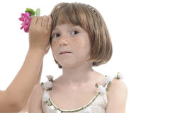 Girl arranging flower Stock Images