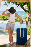 Girl arrived on vacation with suitcase. Summertime Royalty Free Stock Photos