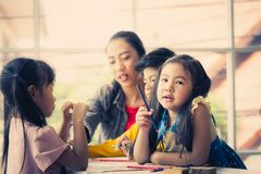 Girl in art classroom is looking at camera. Little Girl in art classroom is looking at camera stock image