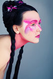 Girl with Art Makeup and Braids Stock Images