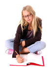 Girl Art Student. Beautiful young female art student ditting on floor sketching in book Stock Images