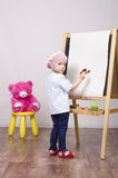 Girl, the artist draws on easel bear Royalty Free Stock Photography