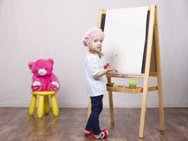 Girl, the artist draws on easel bear Royalty Free Stock Images