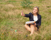 Girl artist draws on nature Royalty Free Stock Photo