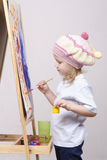 Girl artist paints on canvas Stock Image