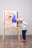 Girl artist paints on canvas Royalty Free Stock Photos