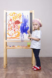 Girl artist paints on canvas Royalty Free Stock Photo
