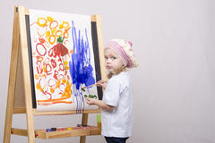 Girl artist paints on canvas Royalty Free Stock Images