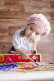 Girl artist paints on canvas Royalty Free Stock Image